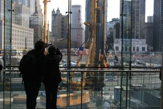 People watch construction at the World Trade Center site.