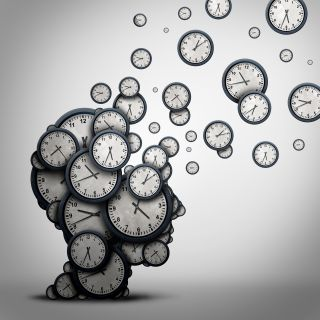 Illustration of a brain made out of clocks
