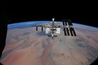 Cosmonaut Oleg Novitsky shared this photo of the International Space Station on Twitter on Sept. 29, 2021. He and two colleagues were relocating a Russian Soyuz spacecraft from one port to another at the time.