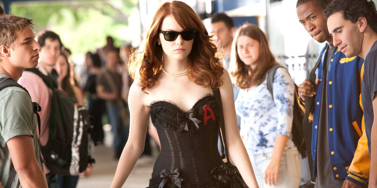 Easy A Emma Stone struts with confidence in sunglasses and a corset