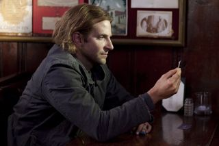 """Character Eddie Mora (played by Bradley Cooper) contemplates taking the memory-boosing drug NZT in the movie """"Limitless."""""""