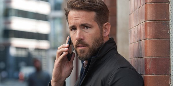 Ryan Reynolds on the phone in the hitman's bodyguard
