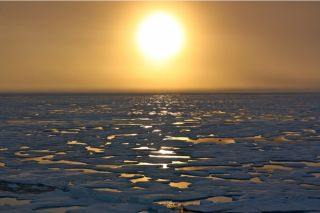 The sun sets on the Arctic Ocean.