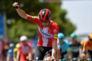 Michael Morkov celebrates a successful lead out for Sam Bennett at the Tour Down Under