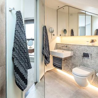 small bathroom with large mirror