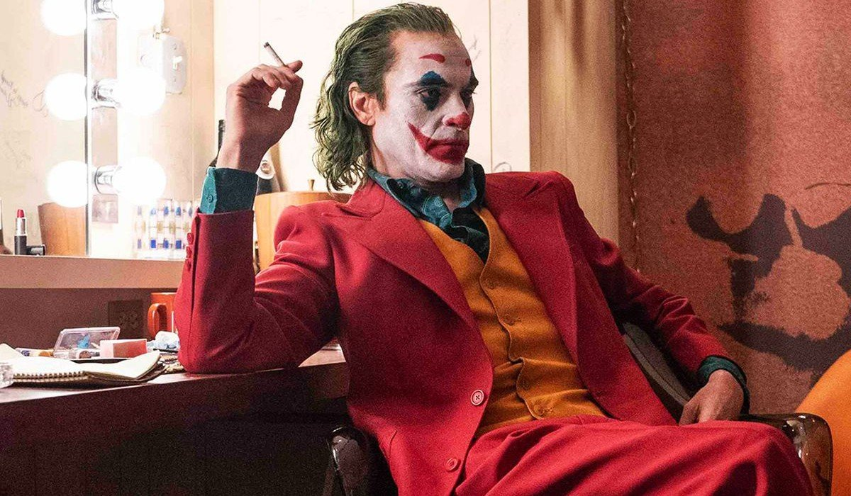 Joker Joaquin Phoenix scowls in the dressing room, while he smokes