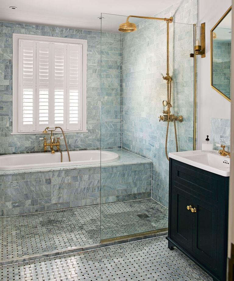 Wet room ideas in a blue tiled bathroom.