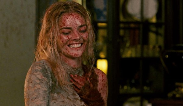 Ready or Not Grace smiles evilly with blood splattered all over her