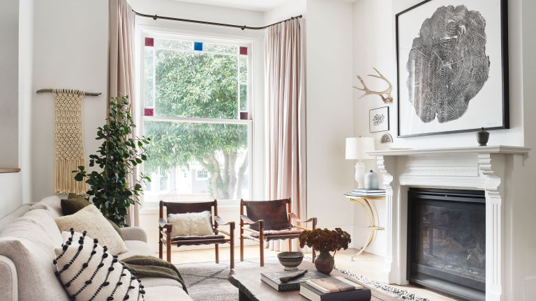 Eclectic white living room in inspiring Victorian renovation