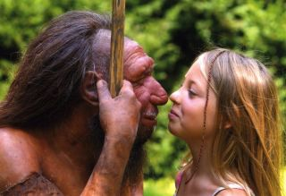 Neanderthal statue with modern human
