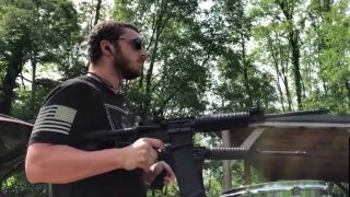 Man playing Slipknot using a gun