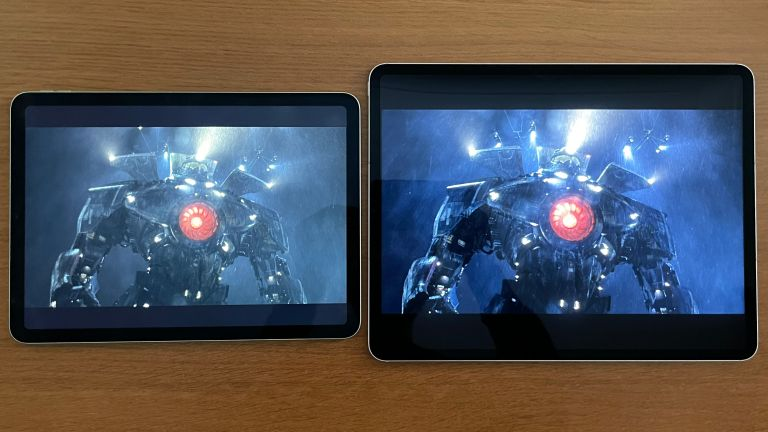 iPad Pro 12.9-inch next to iPad Air 2020, both showing the same still from a movie