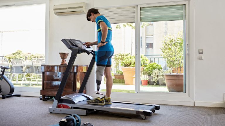 Man with one leg using one of the best treadmills