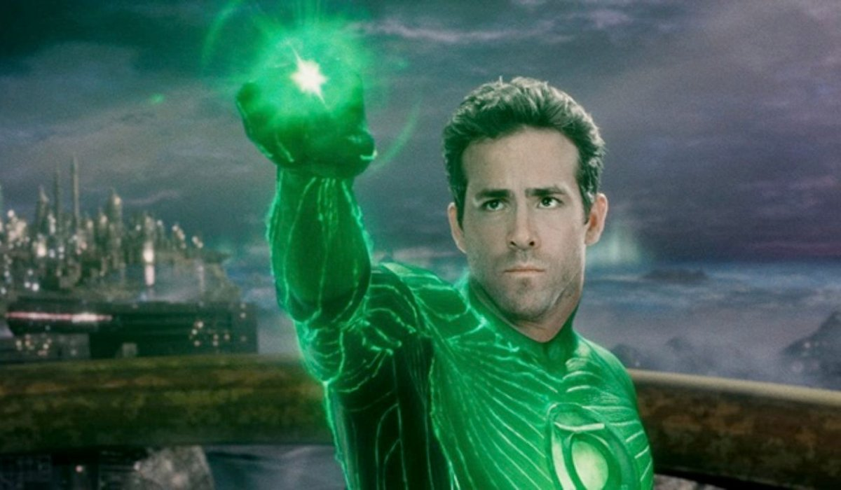 Green Lantern Ryan Reynolds aims his power ring in the air