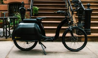 The Civilized Cycles Model 1 electric bike on a New York City sidewalk.