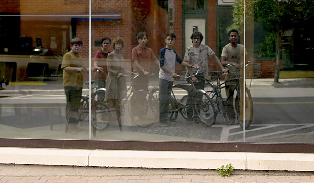 IT Chapter Two The Losers Club reflections of their youth in the store window