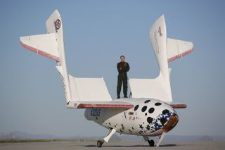 Pilot Brian Binnie stands atop SpaceShipOne, which won the $10 million Ansari X Prize by reaching space twice within the span of two weeks in 2004.