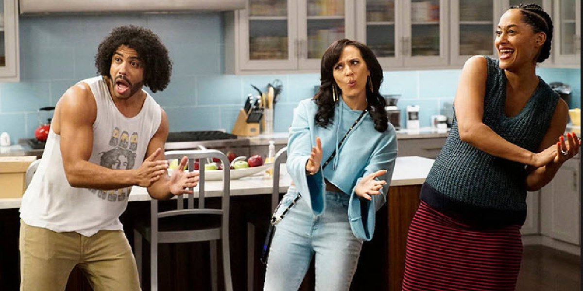Daveed Diggs as Johan Johnson with a couple other cast members in the TV series Black-ish.