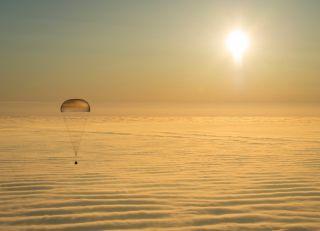 Soyuz Descending Above the Clouds
