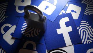 Paper Facebook logos and matching fingerprint cards with a padlock.