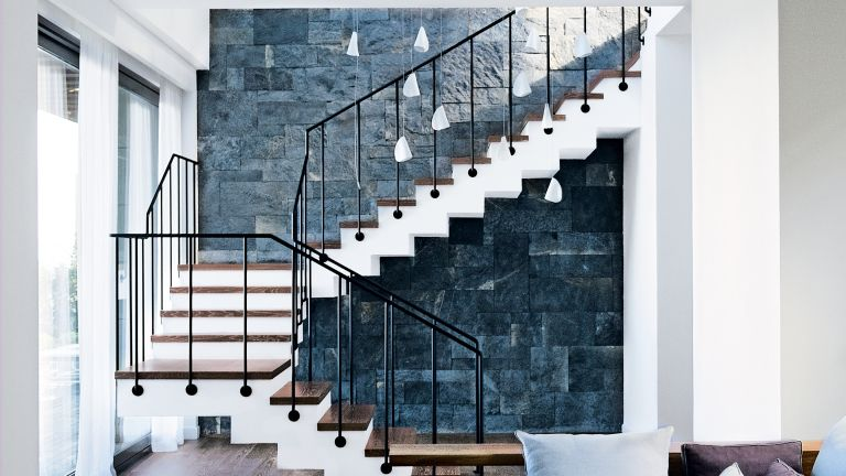 Modern staircase with white pendant lighting