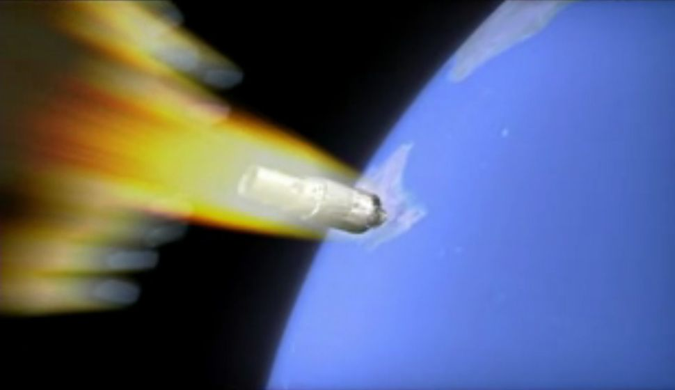 An artist's illustration of China's Tiangong-1 space station falling to Earth as it burns up in the atmosphere. The spacecraft is expected to crash uncontrolled sometime overnight on April 1 or 2, 2018.
