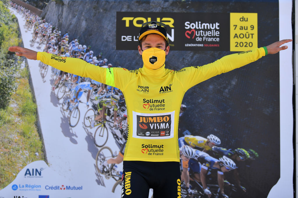 SAINTVULBAS FRANCE AUGUST 08 Podium Primoz Roglic of Slovenia and Team Jumbo Visma Yellow Leader Jersey Celebration Covid safety measures during the 32nd Tour de LAin 2020 Stage 2 a 141km stage from Lagnieu to Llex MontsJura 896m tourdelain TOURDELAIN TDA on August 08 2020 in SaintVulbas France Photo by Justin SetterfieldGetty Images