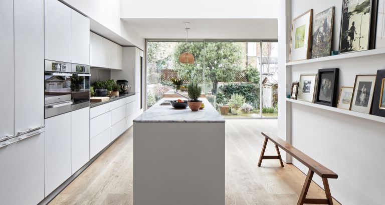 An example of how much does a new kitchen cost showing a white kitchen with a narrow island