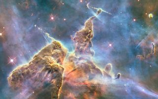 Hubble's 20th anniversary image shows a mountain of dust and gas rising in the Carina Nebula.