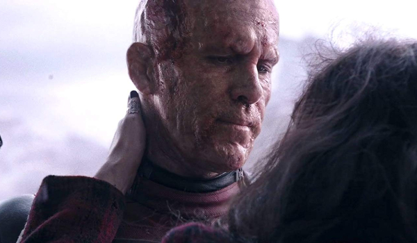 Deadpool Wade shares and embrace with Vanessa