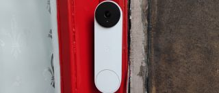 The Google Nest Doorbell (battery) installed on a door frame of a home