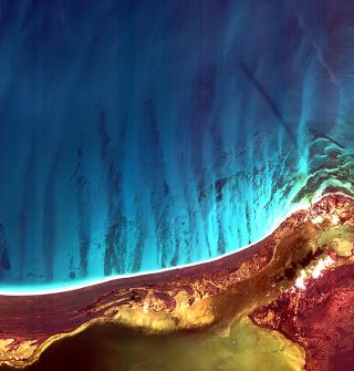 Holbox Island and the Yalahau Lagoon on the northeast corner of Mexico's Yucatan Peninsula are featured in this image, acquired by the Korea Multi-purpose Satellite (Kompsat-2) of the Korea Aerospace Research Institute (KARI).