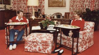 The Reagans dining off of TV trays in the White House, 1981.