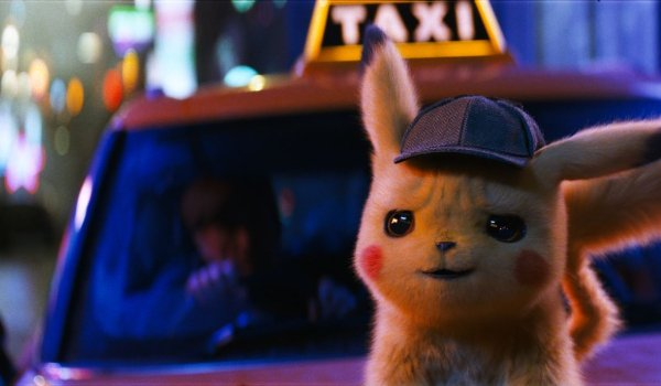 Detective Pikachu standing on a taxi's hood, smirking