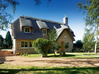 A charming self-build thatched cottage in Cambridgeshire that belies its age through a combination of dutch herringbone patterned brick, Norfolk reed thatch and attention to detail