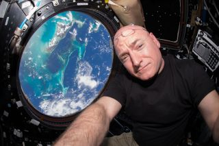 astronaut Scott Kelly seen inside the Cupola