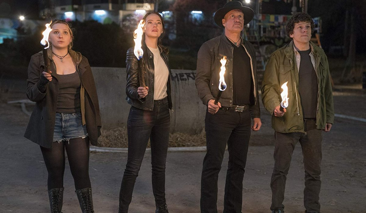 Zombieland: Double Tap the team holds torches in the dark