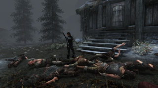 A woman stands in a field of bodies on a grey road