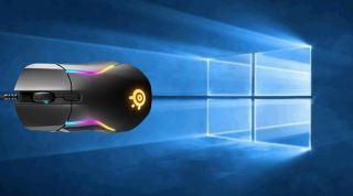 Steel Series gaming mouse in front of Windows 10 background