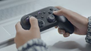 Fingers tap a controller