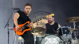 Mike Kerr and Ben Thatcher of Royal Blood perform live on the Main Stage during day one of Reading Festival 2019 at Richfield Avenue on August 23, 2019 in Reading, England.