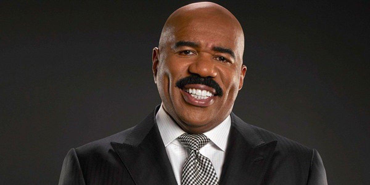 Steve Harvey smiles in promotional photo