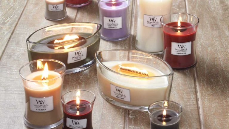 Woodwick candle sale: lots of candles of all different sizes and colours on table