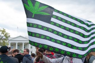 Protesters rally in support of the legalization of marijuana in front of the White House in Washington, D.C., on April 2, 2016.