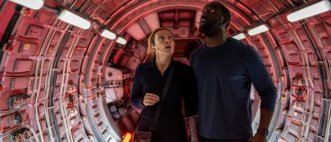 """Toni Collete as Cmdr. Marina Barnett and Shamier Anderson as Michael Adams in """"Stowaway"""" on Netflix."""