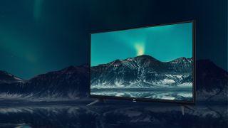 55-inch 4K TV showing mountain range