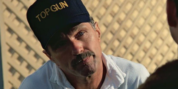 Top Gun Tom Skerritt with his head cocked to the side, looking disappointed