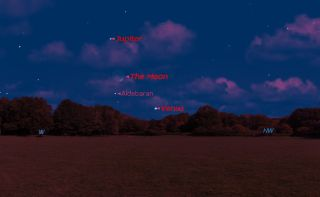 On Saturday, May 11, 2013, after sunset. Venus has now moved into the evening sky, and tonight it and Jupiter frame the slender crescent moon.
