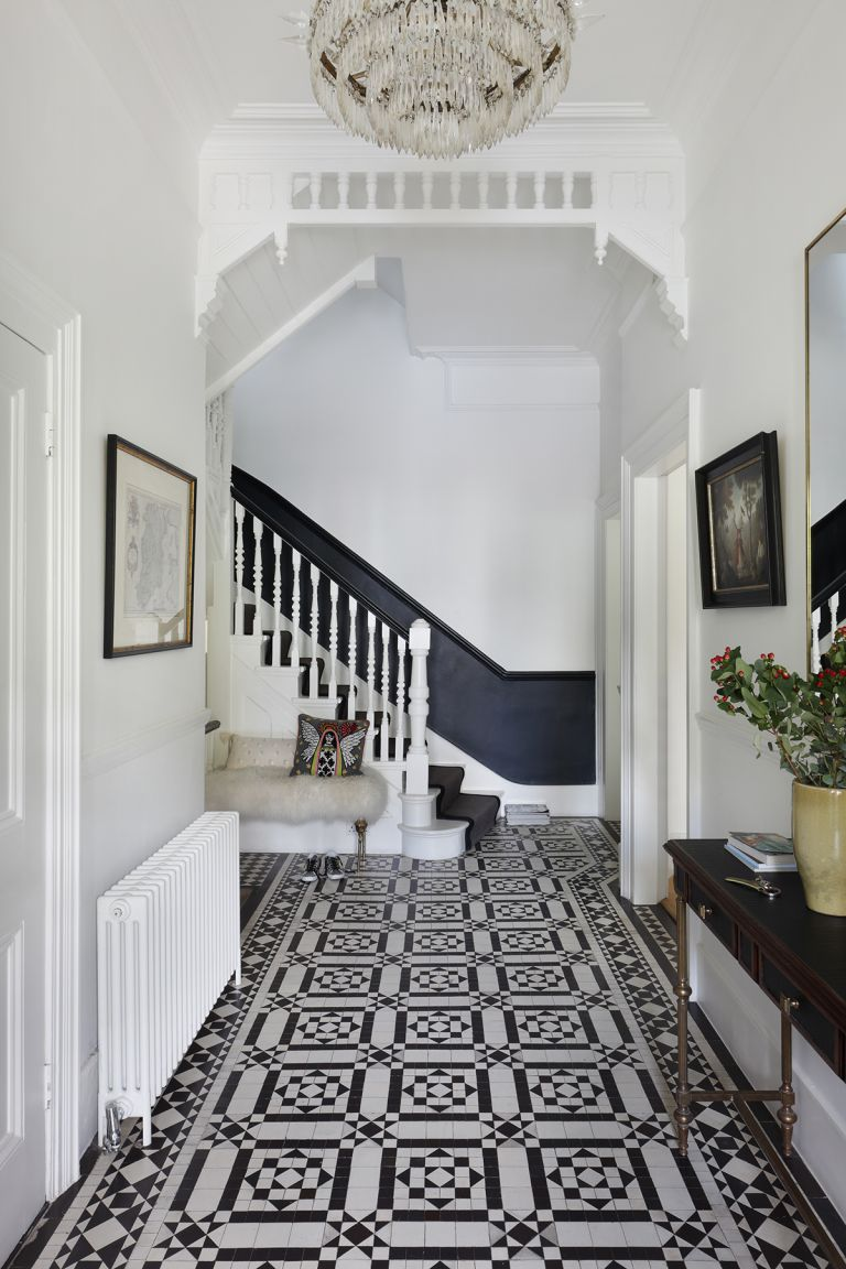 Black and white hallway with patterned tiles