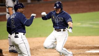 Ray's Michael Brosseau celebrates with Yandy Diaz after hitting a solo home run in the ALDS.